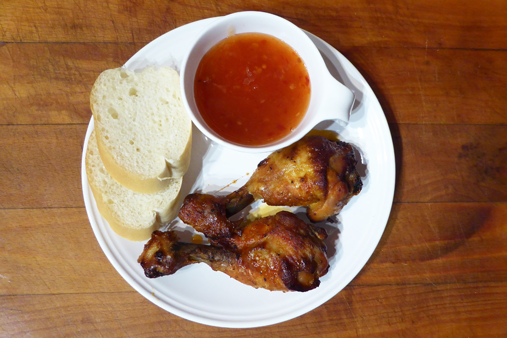 Chicken drumsticks can be served with sweet chilli sauce and baguette. Or, if you find that you have much spice to make řesnekový dip or just dip of yogurt, sour cream and chives.