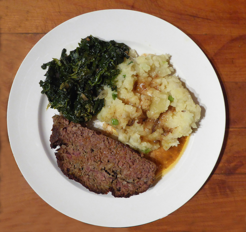 Meatloaf with mashed potatoes and spinach.