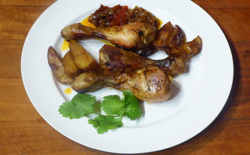 Chicken drumsticks baked potatoes with onion and paprika