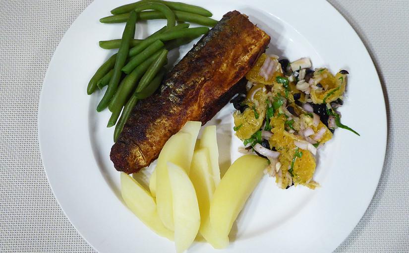 Mackerel in a pan with orange salsa