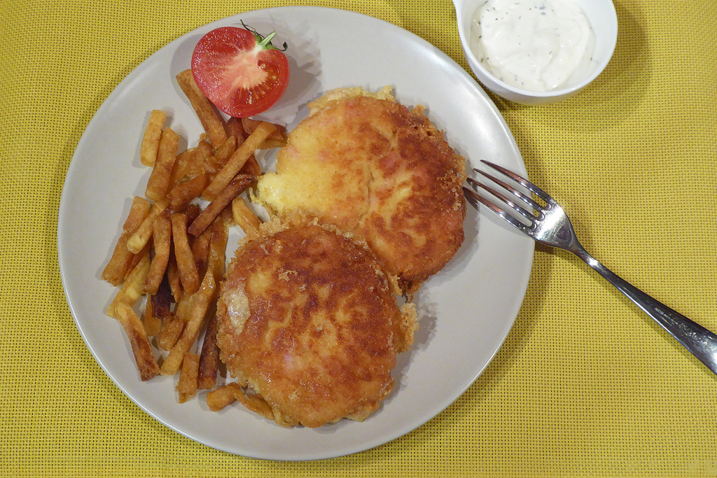 Wild cheese pancakes served with fries and tartar sauce.